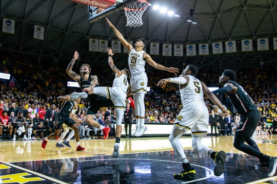Feb 6, 2020; Wichita, Kansas, USA; Cincinnati Bearcats guard Jarron Cumberland (34) is fouled as he shoots the ball in the last seconds of the second half against the Wichita State Shockers at Charles Koch Arena.