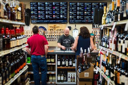 """""""Beer Ninja"""" Brian Wagner behind the bar at Cappy's."""
