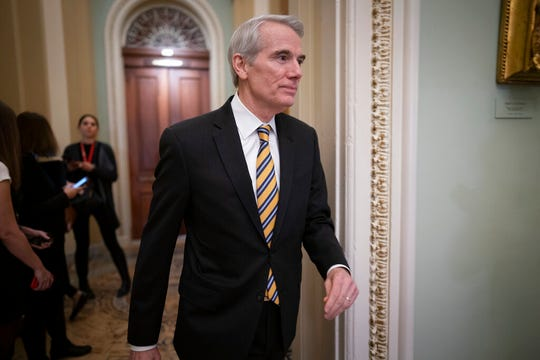 Sen. Rob Portman, R-Ohio, arrives as the impeachment trial of President Donald Trump on charges of abuse of power and obstruction of Congress resumes in Washington, Friday, Jan. 31, 2020. (AP Photo/J. Scott Applewhite)