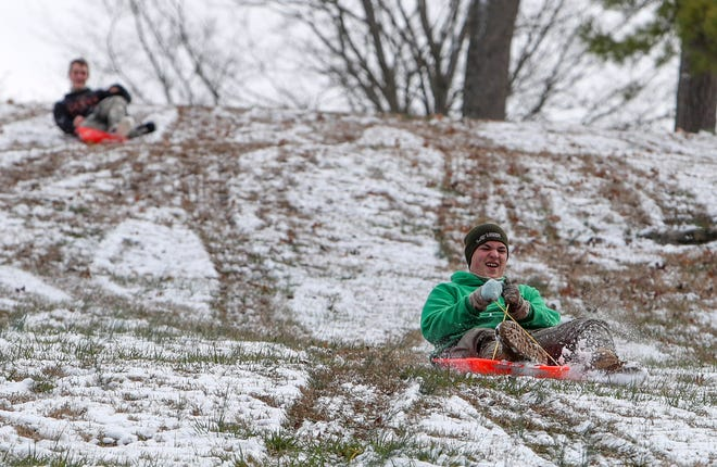 Derek Stilwell, 15, enjoys his day off from school at Kenwood Middle by sledding down the hill in the thin layer of snow at Emerald Hill in Clarksville, Tenn., on Friday, Feb. 7, 2020.