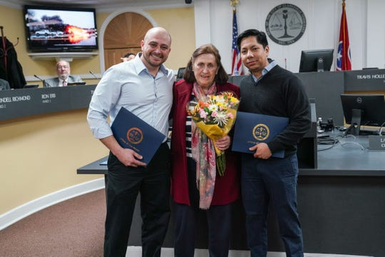Ingeborg Johnson is flanked by Flumencio Brinkley and Sergio Carrillo, who were honored for bravely removing Johnson from a wrecked vehicle just as it burst into flames. The three gathered for a happy reunion at Thursday's City Council meeting, Feb. 6, 2020..