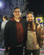 """Director Brad Peyton, left, with the story's original writer, Brian Ralph, formerly of Metuchen, on the set of the adapted Netflix series """"Daybreak."""" Ralph is dressed in costume for a cameo as a zombie-like character."""