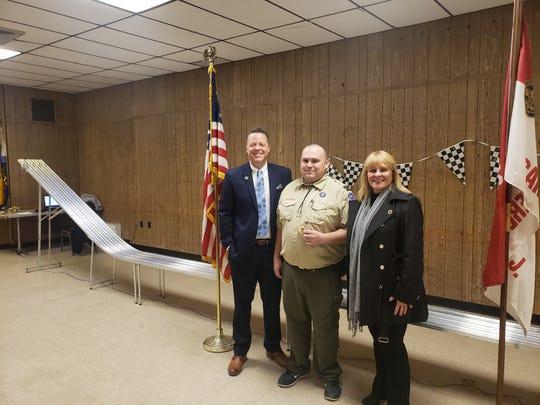 Carteret Mayor Daniel Reiman, along with Councilwoman Susan Naples, awarding Joseph Gadomski Jr. his Scout Master patch.