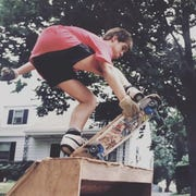 Brian Ralph skateboarding in front of his childhood home on New York Avenue in Metuchen in the late 1980s.