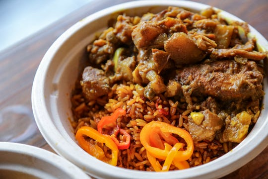 Curry chicken with jollof rice from Yum Village in Detroit.