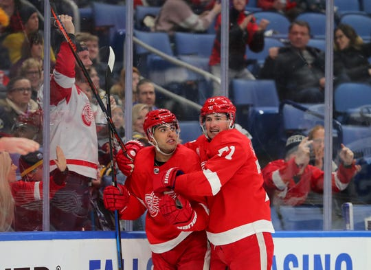 Detroit Red Wings center Dylan Larkin (71) celebrates with center Robby Fabbri after scoring a goal against the Buffalo Sabres during the first period in Buffalo, N.Y. on Feb. 6, 2020.