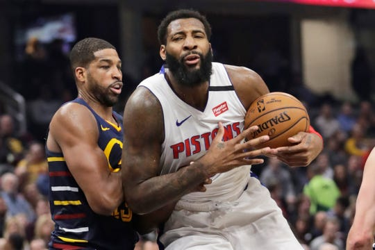 Detroit Pistons' Andre Drummond drives against Cleveland Cavaliers' Tristan Thompson in the second half Jan. 7, 2020, in Cleveland.