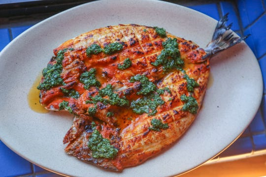 Grilled sea bream topped with tarragon salsa verde from Magnet in Detroit.