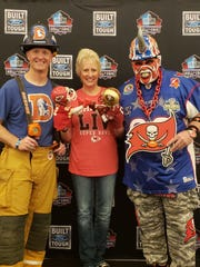 From left, Denver Broncos fan Rob Garner, Kansas City Chiefs fan Janel Renee Carbajo and Tampa Bay Buccaneers fan Keith Kunzig are the newest members of the Ford Hall of Fans at the Pro Football Hall of Fame. They were unveiled at the Merlin Olsen Super Bowl Luncheon held Friday, Jan. 31, 2020 in Miami.