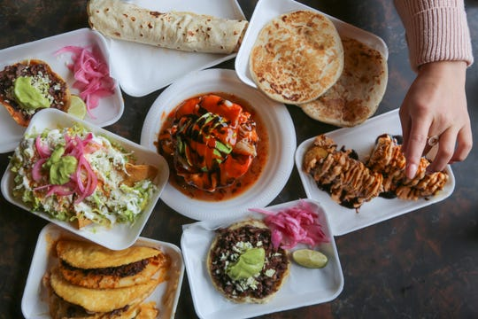 A spread of dishes from Triangulo Dorado in southwest Detroit.