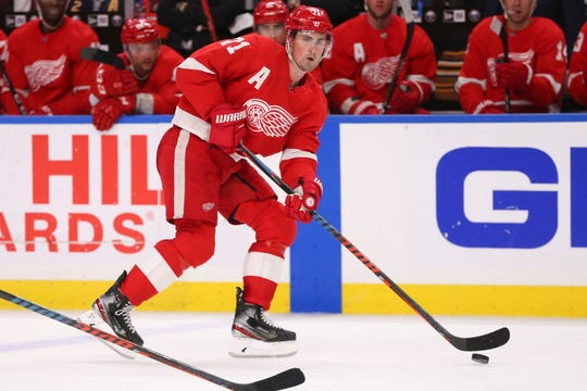 Detroit Red Wings forward Dylan Larkin (71) carries the puck during the second period of an NHL hockey game against the Buffalo Sabres.