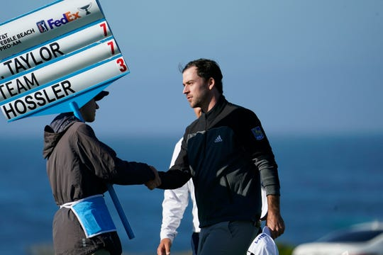 Nick Taylor, right, is greeted after finishing play on the ninth green.
