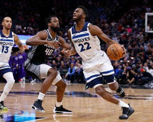 Timberwolves guard Andrew Wiggins, right, was traded to Golden State for D'Angelo Russell on deadline day on Thursday.