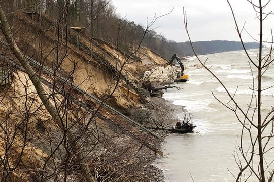 In this Jan. 14, 2020, photo, work continues to rebuild the eroded beach in Fennville, Mich.