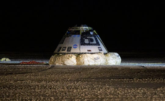 The Boeing Starliner spacecraft is seen after it landed in White Sands, N.M., Sunday, Dec. 22, 2019.