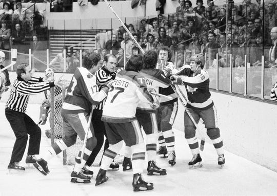 Maple Leafs defensman Brian Glennie, second from right, helps out teammate Jimmy Jones, right, against Rangers forwards Phil Esposito, from left, and Don Murdoch during a game at Madison Square Garden in 1978. Glennie died on Friday at age 73.