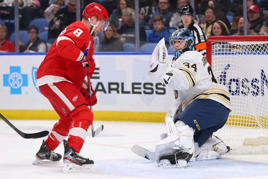 Buffalo Sabres goalie Jonas Johansson (34) stops Detroit Red Wings forward Justin Abdelkader (8) during the second period.