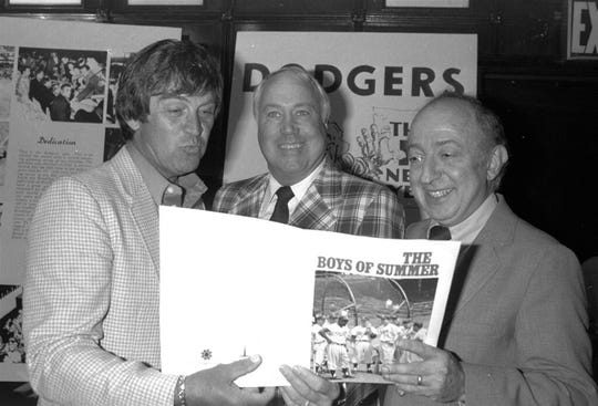 "In this June 24, 1982, file photo, author Roger Kahn, right, joins former Brooklyn Dodger outfielder Duke Snider, center, and former Dodger pitcher, Clem Labine, at the start of production on the television film based on Kahn's best selling book, ""The Boys of Summer,"" in New York."
