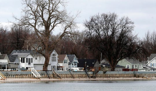 In this Wednesday, Jan. 8, 2020, photo, the dike protecting shoreline homes is seen in Luna Pier, Mich. The small town is considering spending millions to replace dikes built nearly a half-century ago, a steep price for a village of only 1,500 residents.