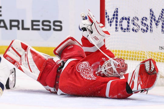 Red Wings goalie Jonathan Bernier reaches to make a save during the third period of the game against the Sabres on Thursday night.