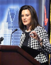 Michigan Governor Gretchen Whitmer speaks before the Detroit Economic Club at TCF Center in Detroit.