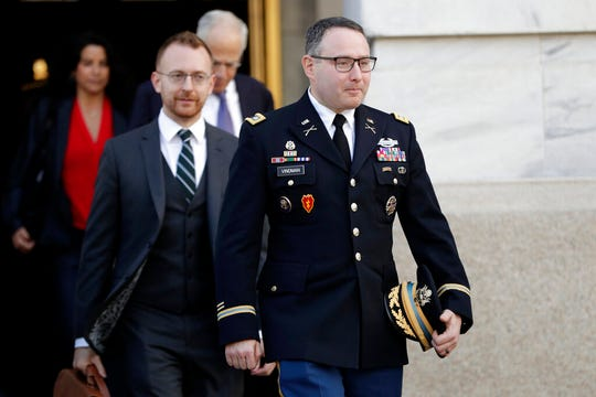 National Security Council aide Lt. Col. Alexander Vindman, leaves after testifying before the House Intelligence Committee on Capitol Hill in Washington, Tuesday, Nov. 19, 2019, during a public impeachment hearing of President Donald Trump's efforts to tie U.S. aid for Ukraine to investigations of his political opponents.