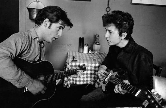 Bob Dylan and John Sebastian jammin' at Cafe Espresso, Woodstock, NY 1964.