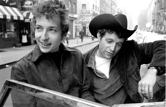 Photographer Douglas R. Gilbert captured this candid image of a young Bob Dylan and Ramblin' Jack Elliot in Greenwich Village, New York in 1964.
