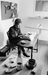 Bob Dylan works in the writing room above Cafe Espresso in Woodstock, NY (1964)