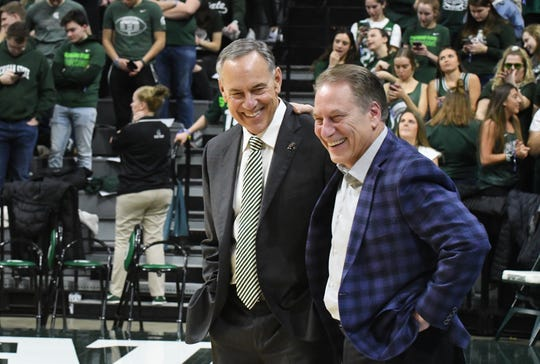 Retired football coach Mark Dantonio and basketball coach Tom Izzo meet on the court before MSU takes on Penn State on Tuesday.