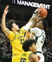 Michigan's Brandon Johns Jr. blocks a shot by Michigan State's Marcus Bingham Jr. in the first half of MSU's win in January.