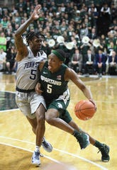 Cassius Winston drives against Penn State in a game in which Michigan State had 15 turnovers.