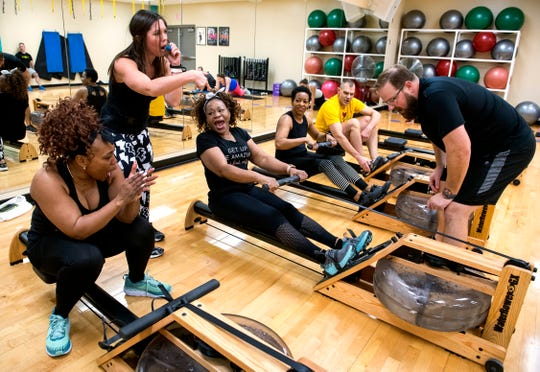 Trainer Jennifer Boester, second from left, instructs the class to encourage Sandra Bard, center, to finish her row in the Shockwave class during the Fit 4 All community fitness event at the Dunigan Family YMCA Saturday morning, Jan. 4, 2020.