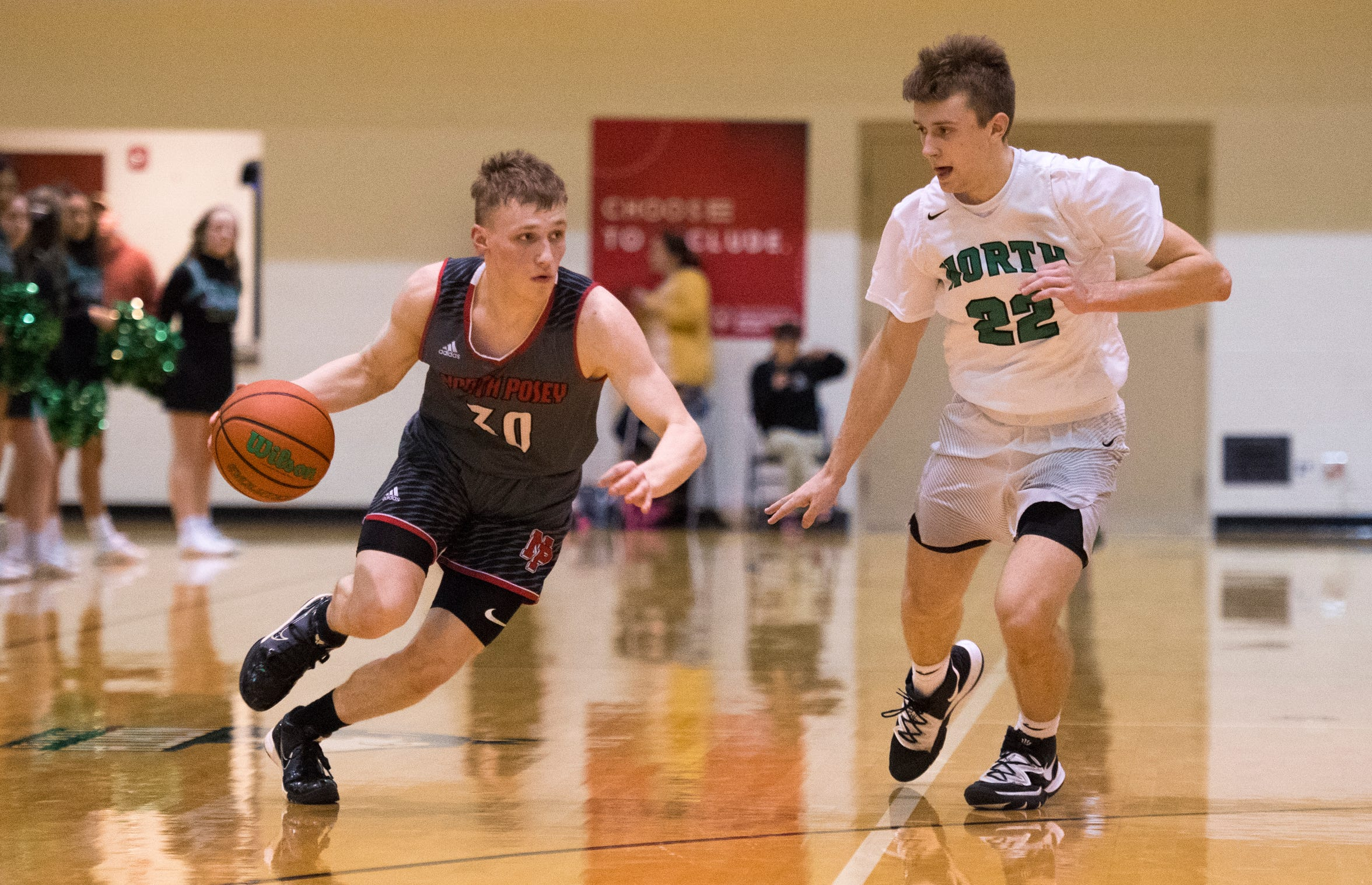 North Posey's Josiah Ricketts (30) dribbles past North's Aidan Blackford (22) during the North Huskies vs North Posey Vikings game at North High School Wednesday evening, Feb. 5. 2020.