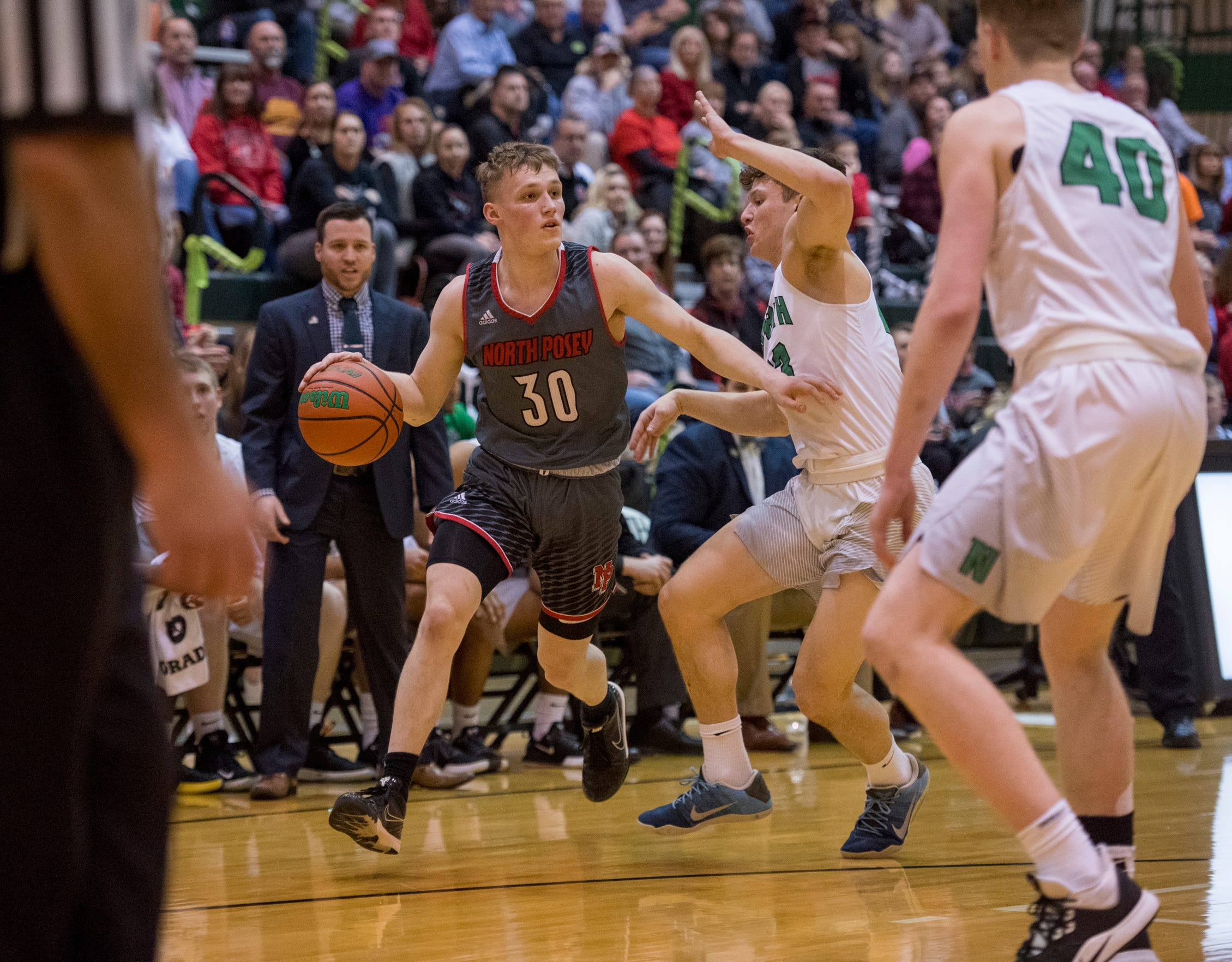 North Posey's Josiah Ricketts (30) looks for an open man during the North Huskies vs North Posey Vikings game at North High School Wednesday evening, Feb. 5. 2020.