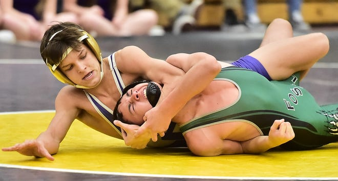 Fort Collins High School wrestler Deklyn Miller works toward a pin in a 132-pound match against Fossil Ridge's Antonio Gallegos during a dual match Thursday, Feb. 6, 2020, at Fort Collins. Miller won the match with a pin in 1 minute and 43 seconds.