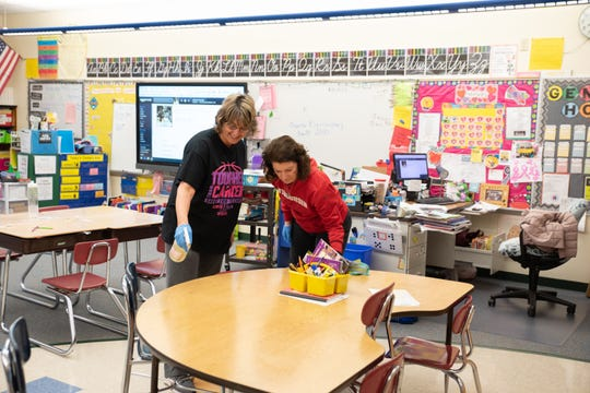 Paraprofessional Penny Schmidt and 3rd grade teacher Rhonda Ross spent Friday morning cleaning a classroom at Oconto Elementary School. The Oconto Unified School District canceled classes on Friday and Monday because so many students were out sick.