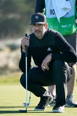Aaron Rodgers lines up a putt during the first round of the AT&T Pebble Beach National Pro-Am golf tournament in February in Pebble Beach, California.