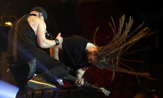 Brantley Gilbert, left, and guitarist Noah Henson get after it during Thursday's stop of the Fire't Up Tour at the Resch Center.