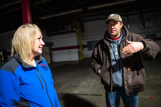 "Barry Crawford, the facility manager for the Hosea Industrial Park in Pickens, recounts Friday, February 7, 2020, the severe rain and flooding which took place at the former OWT Plant Thursday, February 6, requiring a swift water rescue team to transport people to safety. Connie Morgan, left, the office manager for the indoor flea market, located at the former plant building, was carried on Crawford's shoulders to safety. ""I've never had anyone take care of me like that,"" said Morgan."
