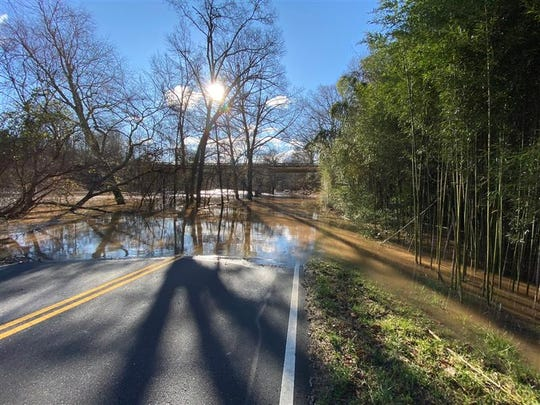 After a day of severe rain and flooding, Old Anderson Road in Powdersville remains closed, Feb. 7, 2020.