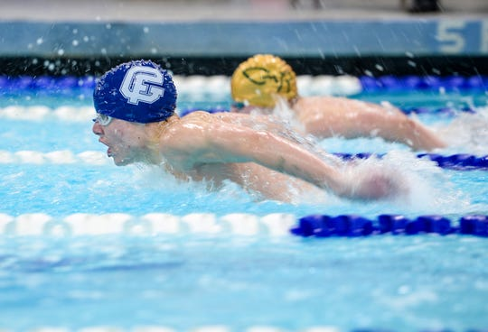 Great Falls High's Pete Anderson swims the 100 yard butterfly during the crosstown swimming meet between CMR and Great Falls High, Thursday night at the Great Falls High pool.