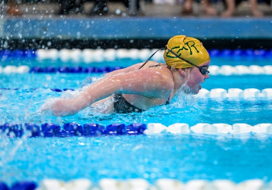 CMR's Shelby Banks swims in the butterfly stroke during the 200 yard IM event at the crosstown swimming meet between CMR and Great Falls High, Thursday night at the Great Falls High pool.