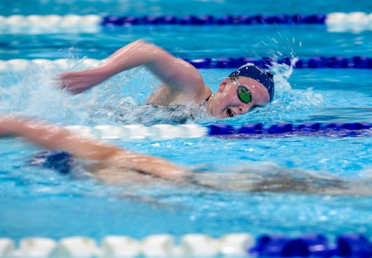 Great Falls High's Claire Earl swims the 500 yard freestyle during the crosstown swimming meet between CMR and Great Falls High, Thursday night at the Great Falls High pool.
