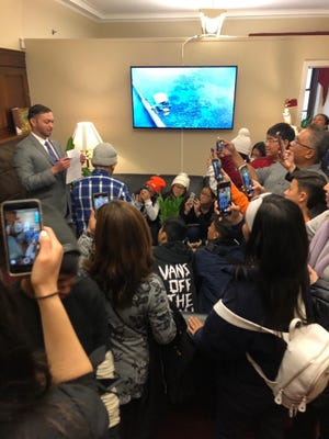 In the presence of more than 40 students and visitors from St. Anthony Catholic School in his Washington, D.C., office, Del. Mike San Nicolas signs a bill seeking to authorize territories to dedicate statues to Statuary Hall in the House of Representatives