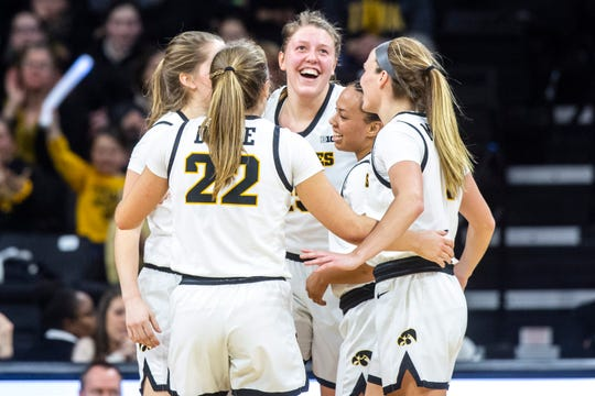Iowa center Monika Czinano, middle, is embraced by teammates Kate Martin, Kathleen Doyle, Alexis Sevillian, and Makenzie Meyer after drawing a foul during a NCAA Big Ten Conference women's basketball game against Nebraska, Thursday, Feb. 6, 2020, at Carver-Hawkeye Arena in Iowa City, Iowa.