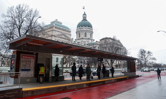 Passengers board the IndyGo Red Line on Capitol Avenue, Indianapolis, Thursday, Feb. 6, 2020.