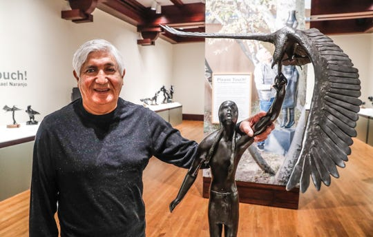 """Native American artist Michael Naranjo stands by one of the bronze sculptures included his current show at the Eiteljorg Museum in Indianapolis, """"Please Touch! The Sculptures of Michael Naranjo."""" The show features work spanning his 50-year sculpting career. Naranjo was blinded by a grenade and suffered other injuries while serving in Vietnam."""