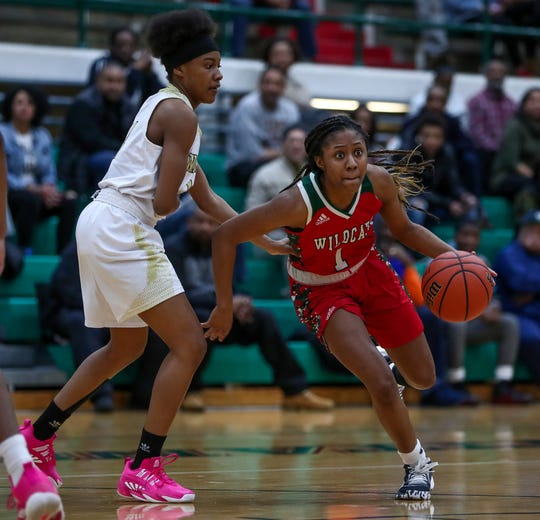 Lawrence North Wildcats' Kristian Young (1) drives against the Warren Central Warriors during sectional semifinal play at Arsenal Technical High School on Friday, Feb. 7, 2020.