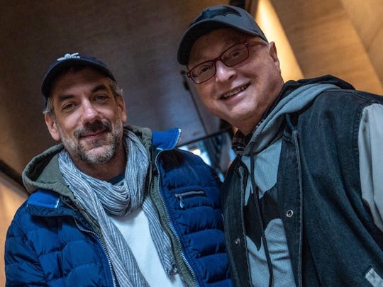 """Michael Uslan, right, poses for a photo with """"Joker"""" director Todd Phillips."""